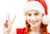 Happy santa helper showing victory sign — Stock Photo