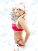 Santa helper with mirror balls and snowflakes — Stock Photo