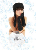 Glitterball girl with snowflakes — Stock Photo