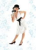 Pretty lady with black mask and snowflakes — Stock Photo