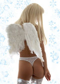 Lingerie angel with snowflakes — Stock Photo