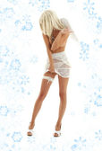 White angel on high heels with snowflakes — Stock Photo