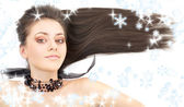 Lovely brunette in black collar with snowflakes — Stock Photo