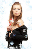 Lovely girl with heart-shaped blower and snowflakes — Stock Photo