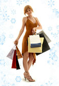 Shopping redhead with snowflakes — Stock Photo