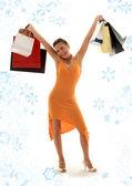 Shopping euphoria with snowflakes — Stock Photo