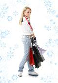 Nastolatka z torby na zakupy i płatki śniegu — Zdjęcie stockowe