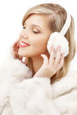 Smiling blond in furry headphones — Stock Photo