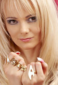 Aggressive golden jewelry girl — Stock Photo