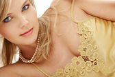 Mysterious blue-eyed blond in pearls — Stock Photo