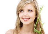 Blue-eyed blonde with bamboo — Stock Photo