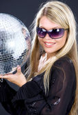 Party girl with disco ball — Stock Photo