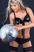 Party dancer in black lingerie with disco ball — Stock Photo