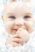 Baby with snowflakes — Stock Photo