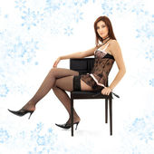 Black lace brunette in chair with mask — Stock Photo