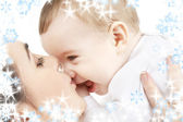 Happy mother kissing baby boy — Stock Photo