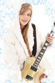 Golden guitar girl in fur — Stock Photo