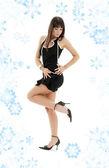 Black dress brunette on high heels — Stock Photo