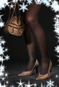 Long legs in snakeskin shoes with handbag — Stock Photo