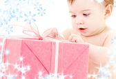 Baby boy with gift box — Stock Photo