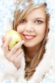 Lovely blond in fur with apple — Stock Photo