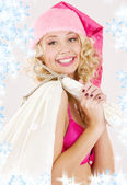 Cheerful santa helper girl with big bag — Stock Photo