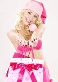 Santa helper with pink shopping bags — Stock Photo