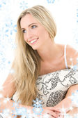 Happy blonde with pillow — Stock Photo