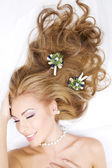 Lovely woman with christmas decorations in hair — Stock Photo
