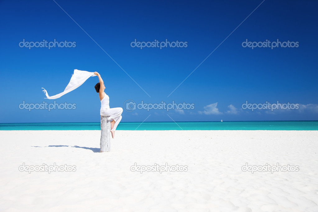 Happy woman with white sarong on the beach — Stock Photo #11760956