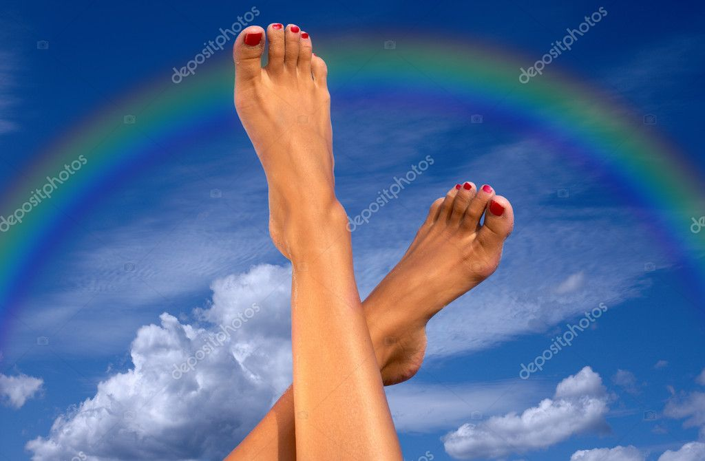 Female legs over blue sky with clouds and rainbow — Stock Photo #11761294