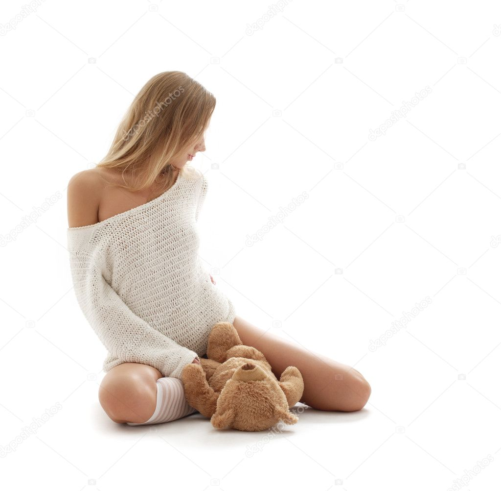 Picture of lovely blond in white sweater with teddy bear — Stock Photo #11761827