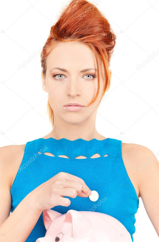 Picture of lovely woman with piggy bank  Stock Photo #11762346