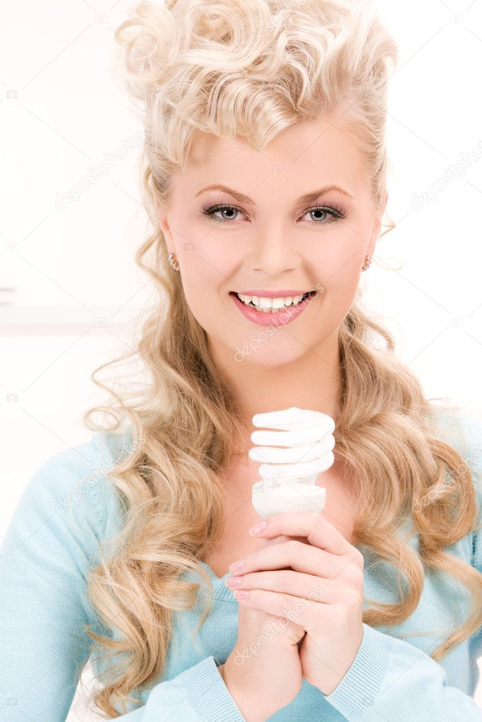 Bright picture of woman holding energy saving bulb — Stock Photo #11763509