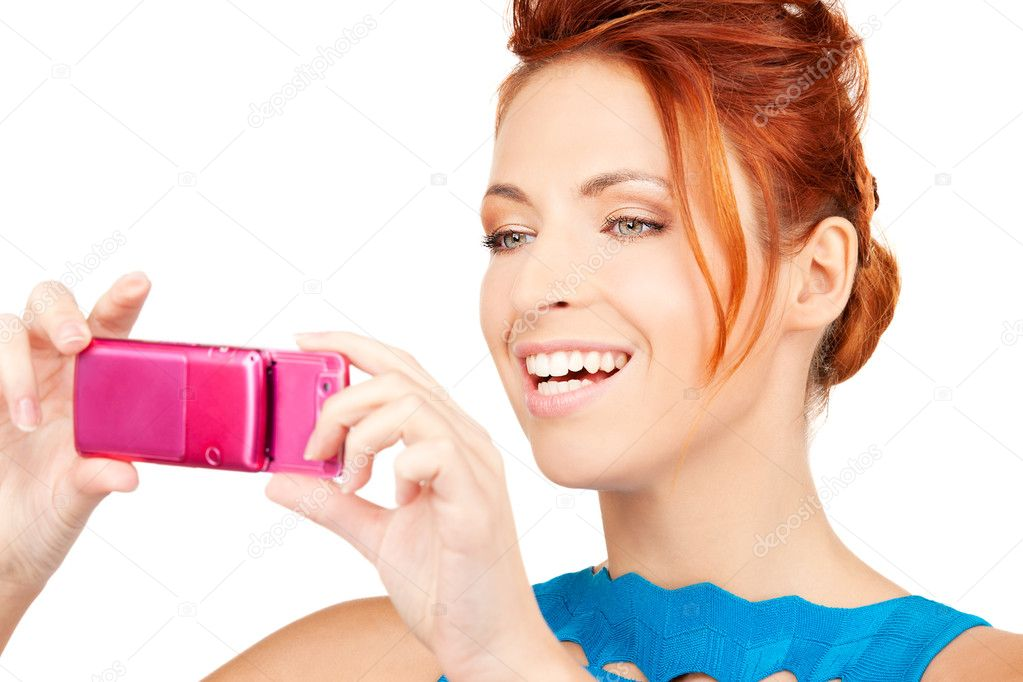Picture of happy woman using phone camera — Stock Photo #11763569