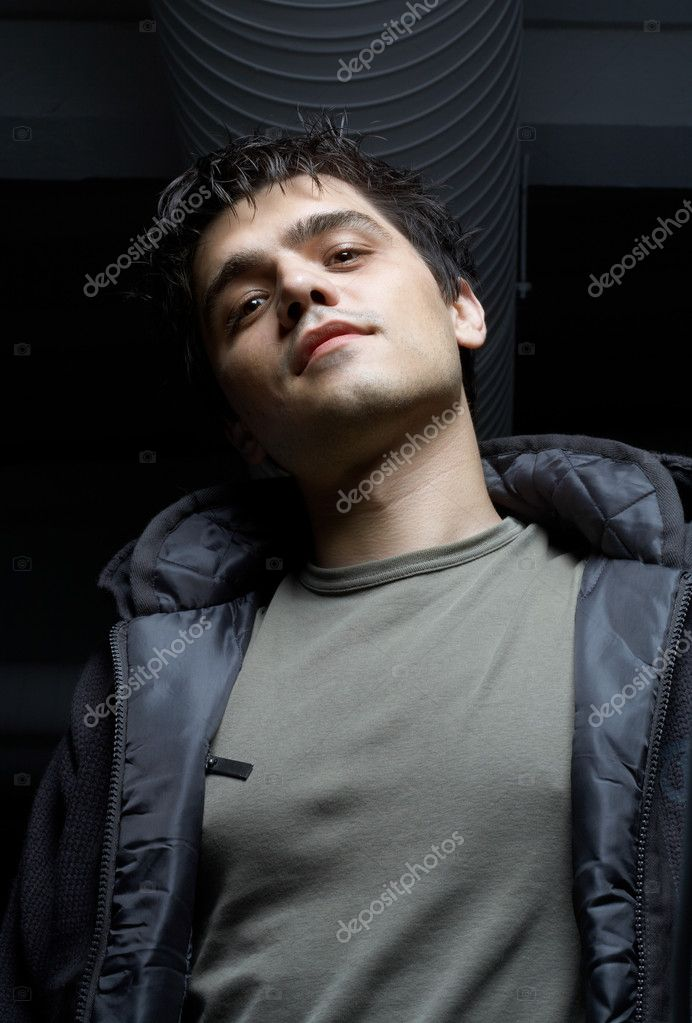 Dark portrait of street mobster in industrial building basement  Stock Photo #11763980
