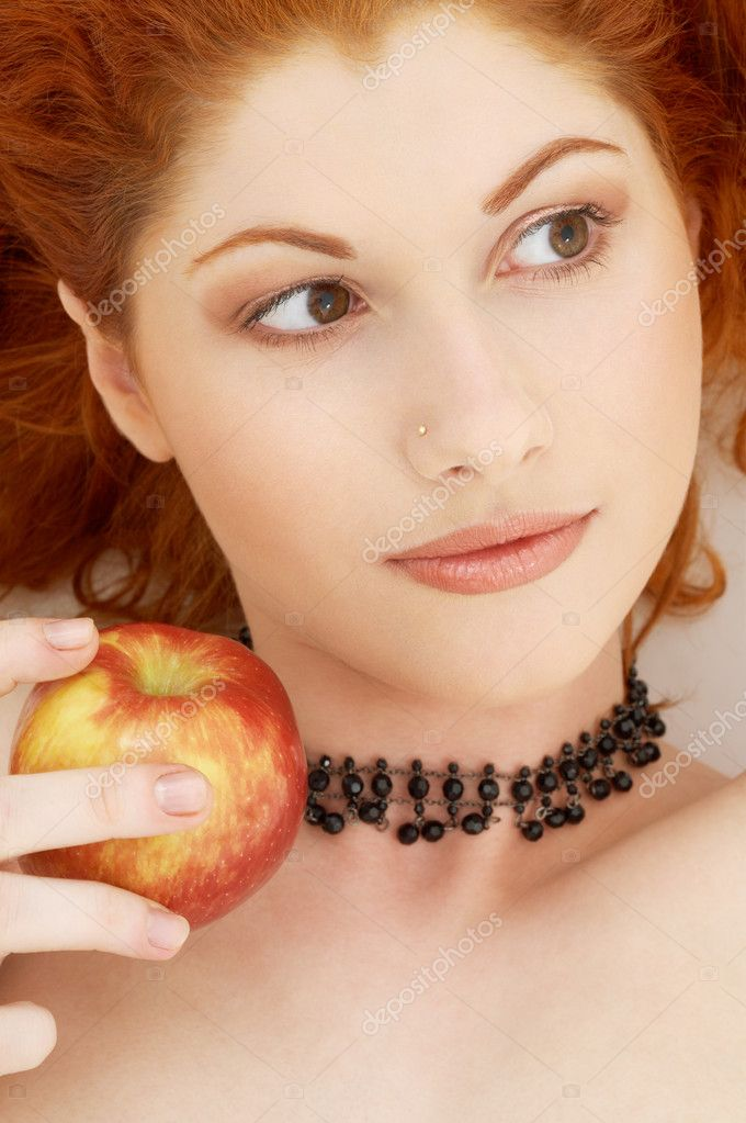 Picture of lovely redhead with delicious apple — Photo #11764073