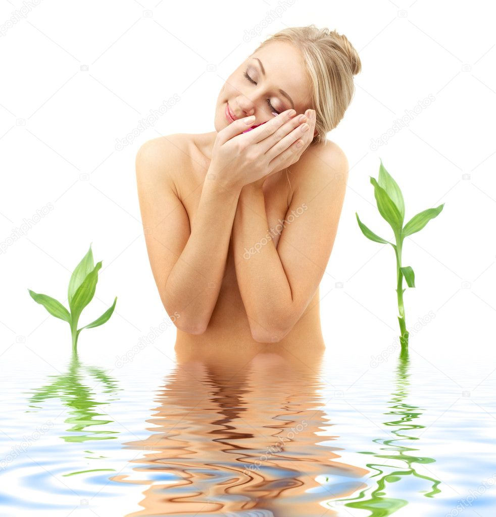 Picture of blonde with flower petals and green plants in spa — Stock Photo #11765676