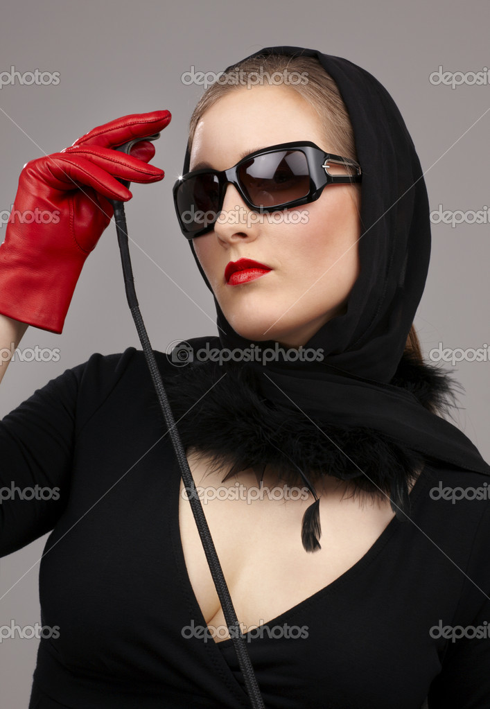 Portrait of lady in black headscarf and red gloves with crop  Stock Photo #11765777