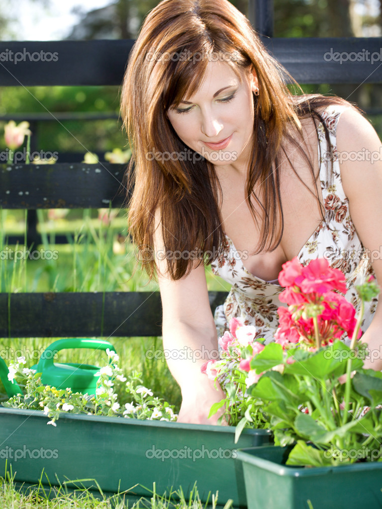 Bright picture of lovely housewife potting plants — Stock Photo #11766387