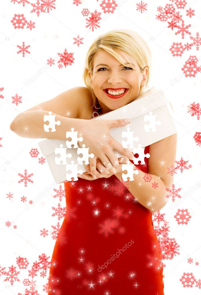 Thankful girl holding puzzle box surrounded by snowflakes — Stock Photo #11766961