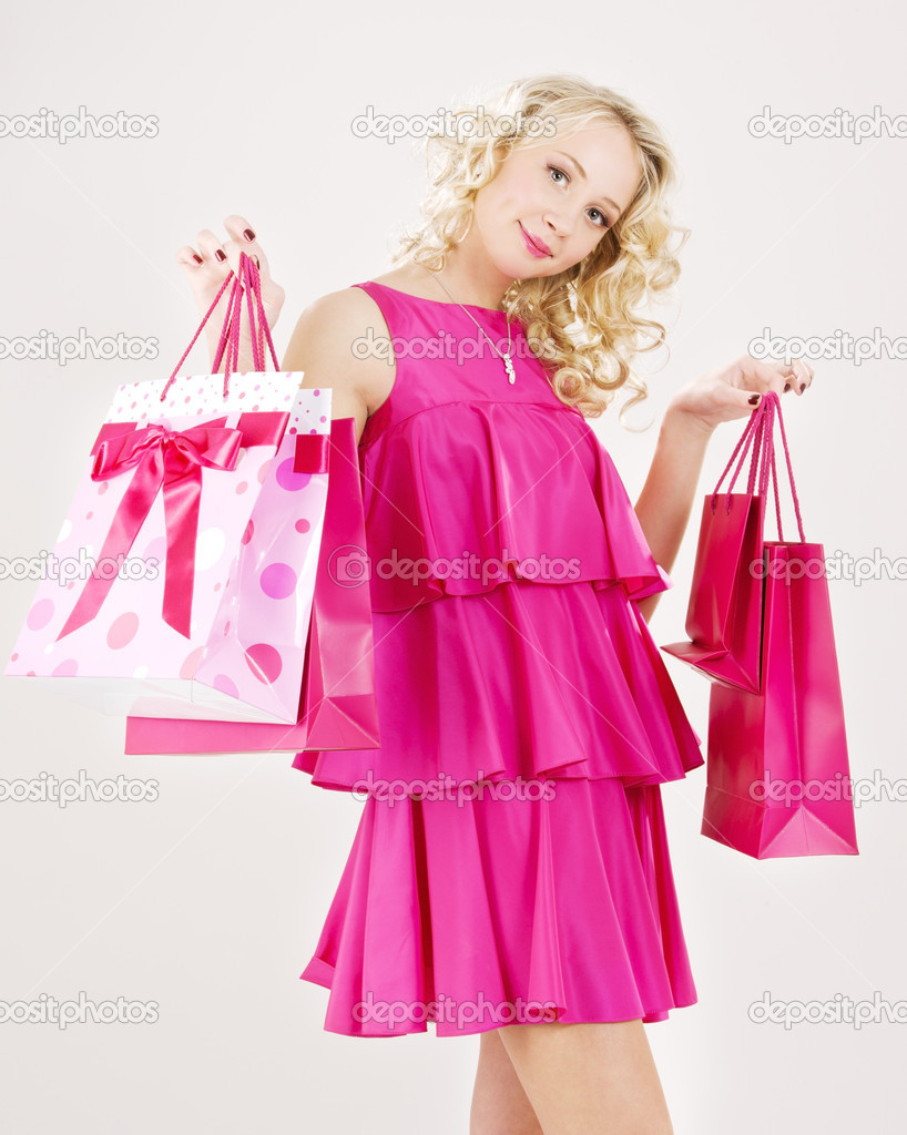 Elegant blonde girl with pink shopping bags — Stock Photo #11768321