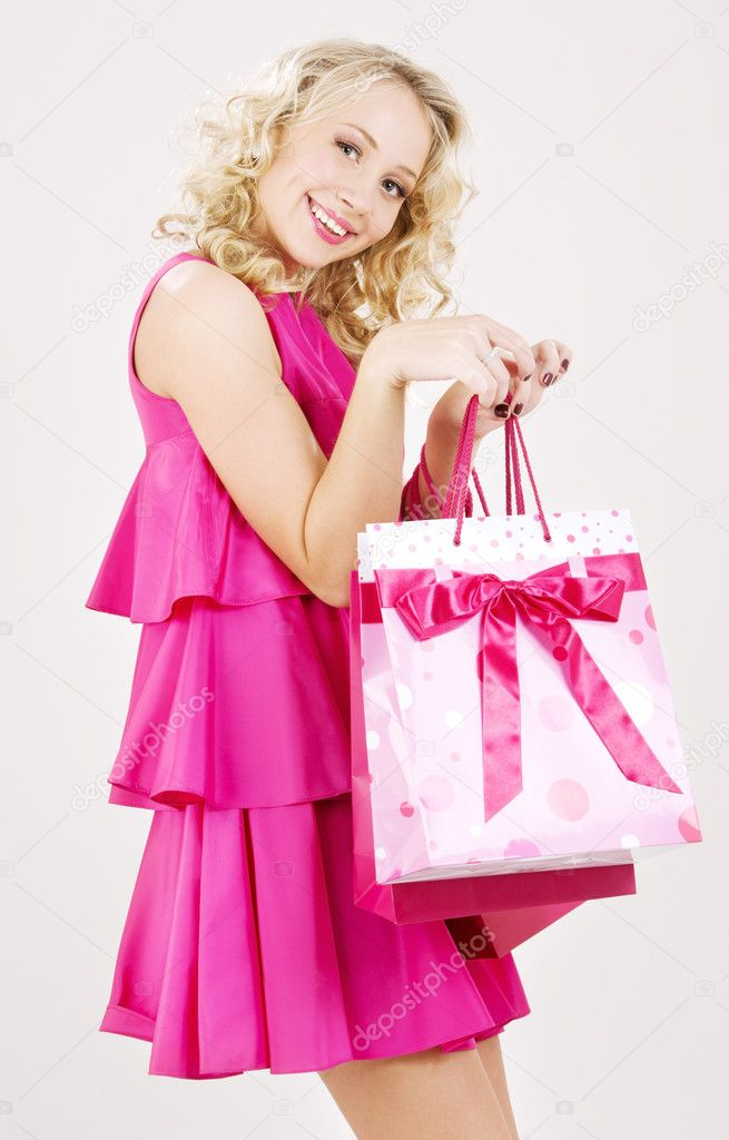 Elegant blonde girl with pink shopping bags — Stock Photo #11768323