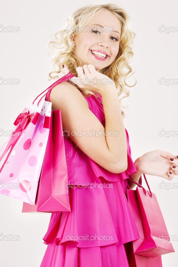 Elegant blonde girl with pink shopping bags — Stock Photo #11768325