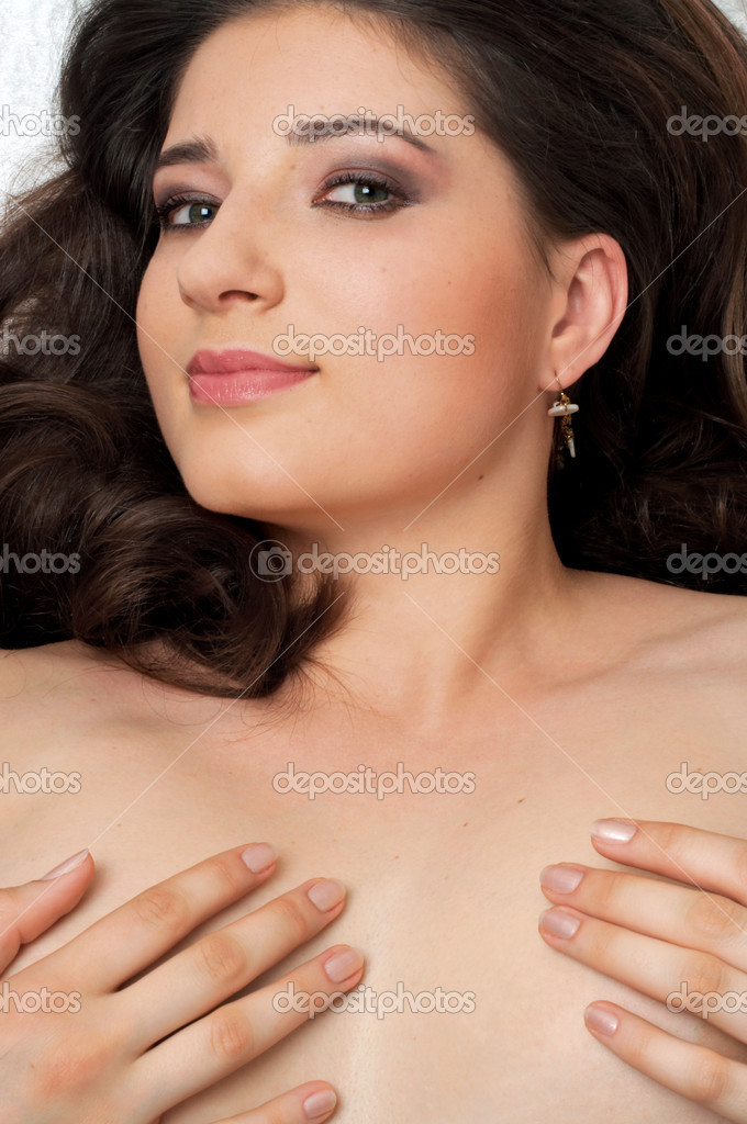 Romantic portrait of naked brunette — Stock Photo #11768529
