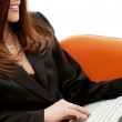 Businesswoman in chair with laptop — Stock Photo #11770212