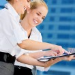 Two happy businesswomen with paper chart — Stock Photo