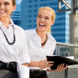 Stock Photo: Two happy businesswomen with folders