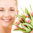 Happy woman with flowers — Stock Photo