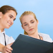 Two happy businesswomen with documents — Stock Photo